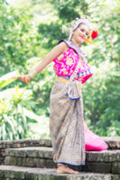 Asian woman wearing typical, traditional Thai Dress. It is literally means