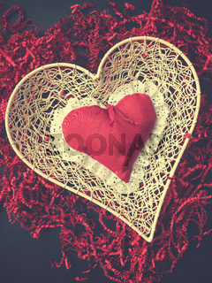 Red heart shape on shredded paper, vintage colors