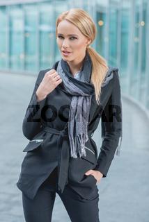 Woman Posing in Black Fashionable Corporate Attire