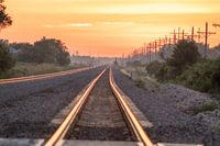 Rail Road crossing and tracks at sunset