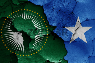 flags of African Union and Somalia painted on cracked wall