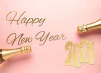 The words Happy New Year with golden 2021 and champagne