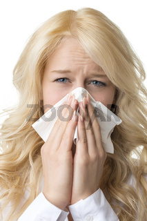 Ill woman with tissue is sneezing