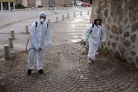 Workers spray disinfectant COVID-19 coronavirus