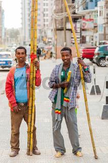 Men selling sugarcane on the street
