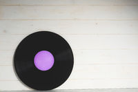 Old violet vinyl record isolated