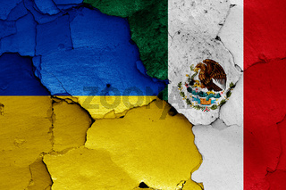flags of Ukraine and Mexico painted on cracked wall