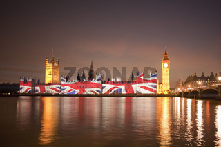Union Jack Flag projected onto the Houses of Parliament at dusk