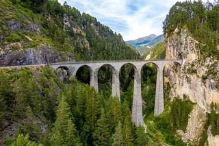 Famous viaduct near Filisur in the Swiss Alps called Landwasser Viaduct - Switzerland from above