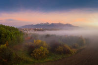 beautiful landscape with valleys, mountains in High Tatras in fog