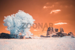 Ruins of gothic medieval castle Lichnice in infrared spetrum, IR photography, Iron Mountains, Pardubice region, Czech republic. Castle ruins.