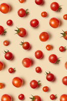 Vegetable pattern with ripe fresh organic cherry tomatoes.
