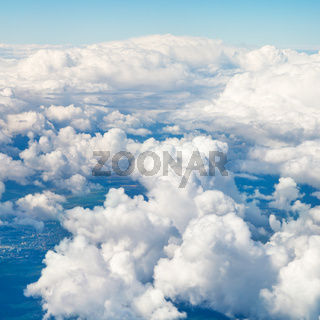 clouds in blue sky and earht under clouds