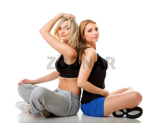 Two young sporty women after workout