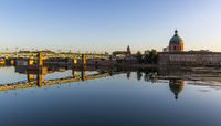 Beautiful reflection of the Saint Pierre bridge and Saint Joseph Dome in the River Garonne, Toulouse