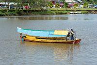 By Sampan crossing the Sarawak river in Kuching