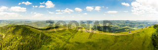 Aerial drone view 180 degrees scenic panoramic landscape of nature in Carpathians, Ukraine. The top of the mountain named Vysokyy Verkh, beautiful and a picturesque place popular with tourists