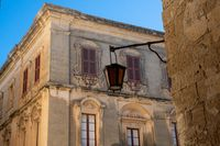 Traditional  Maltese house Mdina Malta with Lamp and red shutters