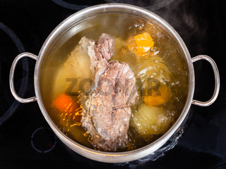 open pan with cooking beef broth