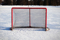 Views of a hockey net on an outdoor rink