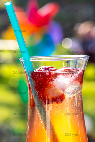 Strawberry Cocktail with summer feeling and sunshine in the garden.