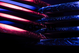 Two forks in colorful illumination macro shot creating an abstract composition suitable as a background.