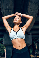 Beautiful sporty woman posing enjoying summer morning outdoors