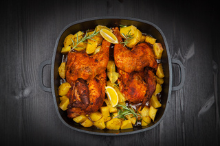 Tasty baked chicken with potatoes and herbs