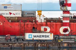 Crane unloading container cargo ship Sevmorput Rosatomflot - Russian nuclear-powered icebreaker lighter aboard ship carrier