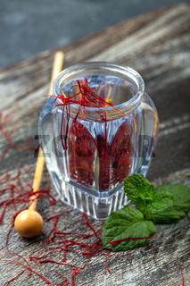 Saffron in a vial. Precious Oriental spice.