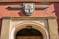 Weißenfels, Germany - 06/18/2019 - old front door with coat of arms