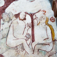 Adam and Eve sit under the tree in the paradise and are chatting. Mural in Kavlinge church, Sweden