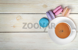 Macaroons and cup with coffee on top