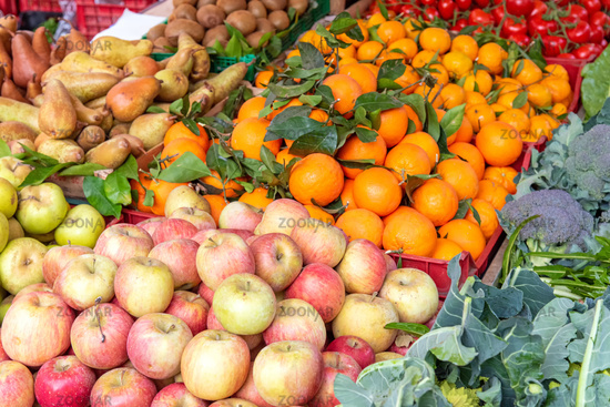 Apples, tangerines and other fruits and vegetables for sale at a market