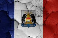 flag of Novgorod Oblast painted on cracked wall