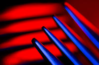Prongs of one fork in colorful illumination macro shot creating an abstract composition suitable as a background.