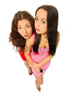 Funny portrait of two young girls isolated