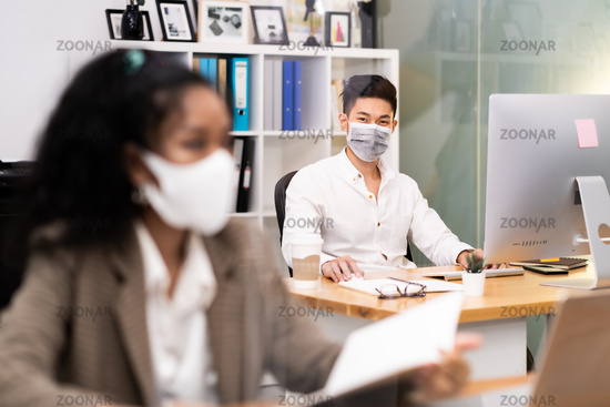 Asian employee face mask in new normal office