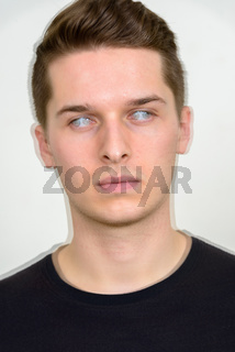 Portrait of young handsome man with multiple exposure effect