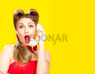 Pin-up girl talking on retro telephone