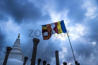 A Stupa, Clouds and a flag, Anuradhapura, Sri Lanka