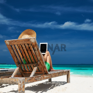 Young woman with tablet pc at the beach