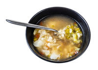 stelline and vegetables soup in bowl with spoon