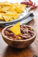 Chili con carne and tortilla chips. Mexican food with beans.