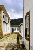 Paving stones in the streets with colonial houses in Tiradentes city