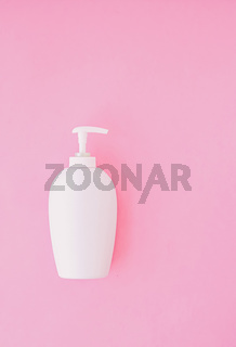 Bottle of antibacterial liquid soap and hand sanitizer on pink background, hygiene product and healthcare