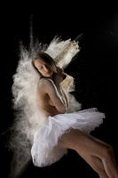 Gentle young female dancer in tutu and powder in studio