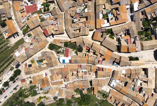 Directly from above view ancient houses rooftops and roads, view from top. Montesa village. Spain