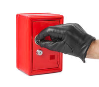 Hand and red toy safe