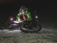 Woman is taking part in trail biking race